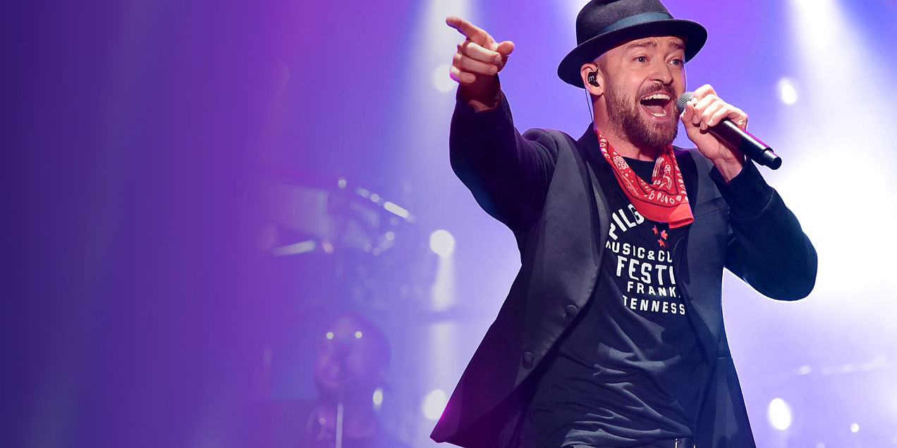 Justin Timberlake singing with a microphone in hand.