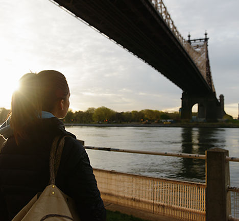 Woman looking at the underside of a bridge